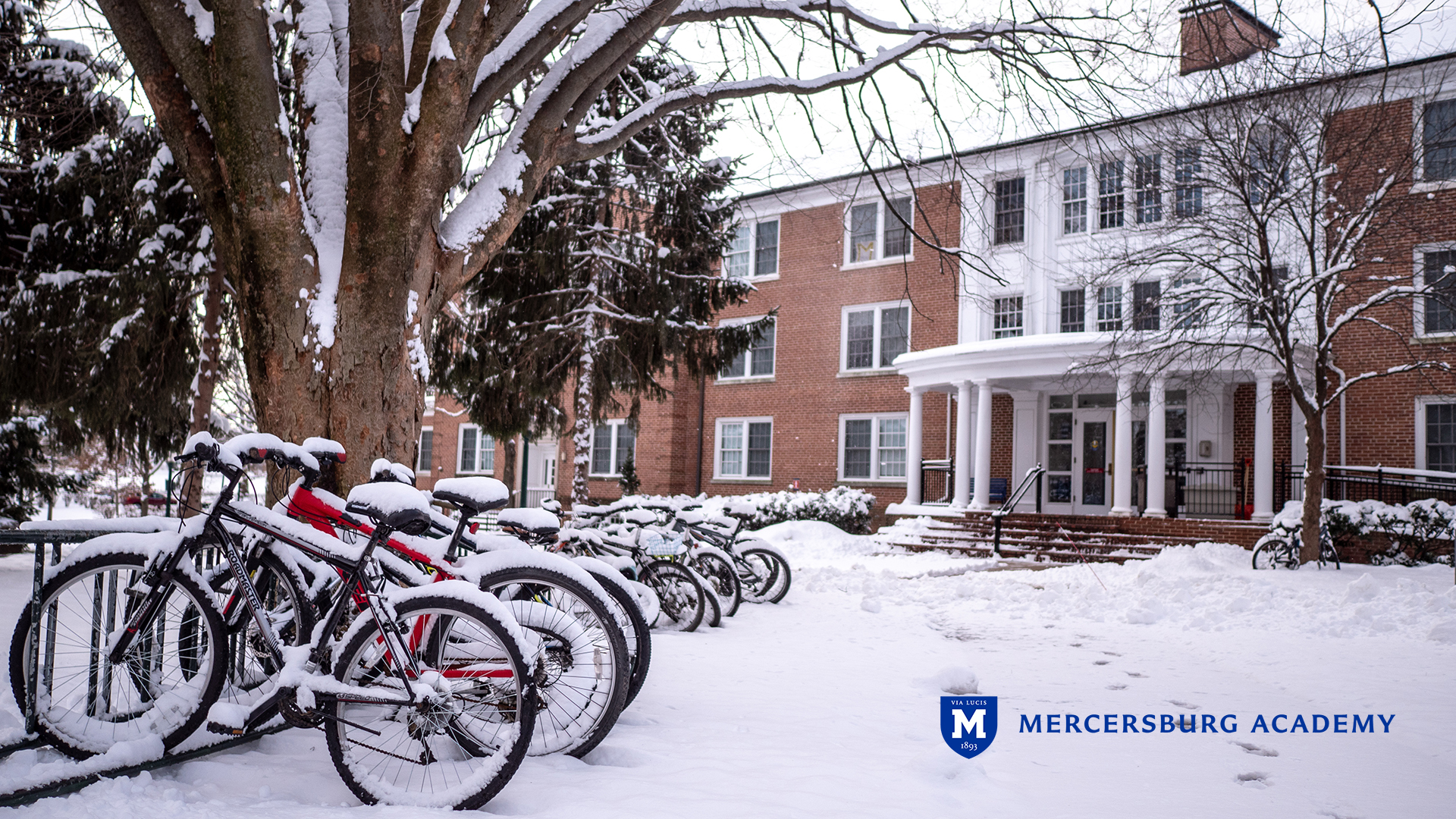 Bikes with snow in front of Tippetts Hall